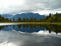 Lake Matheson New Zealand. Mirror image created by the stillness of the water Royalty Free Stock Photography