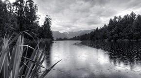 Lake Matheson in New Zealand Mountains. Lake Matheson, New Zealand on a rainy day Royalty Free Stock Images