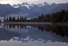Lake Matheson Reflection. Mount Cook and Tasman reflected in Lake Matheson at sunrise Stock Photos