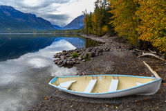 Lake McDonald Boat. A boat rest on the shore of Lake McDonald in Glacier National Park, Montana in the fall Stock Photo