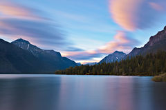 Lake McDonald, Glacier NP. Lake McDonald in Glacier National Park, Montana soaks up the last bit of color as the sun fades to the west Stock Photos
