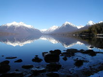 Lake McDonald Reflection. This is Lake McDonald in Glacier National Park during a warm late winter day Royalty Free Stock Photos