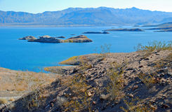 Lake Mead area near Boulder (Hoover) Dam. The image shows a part of Lake Mead near Boulder Dam (Hoover) Dam. The  land in the Stock Photo