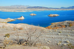 Lake Mead area near Boulder (Hoover) Dam. The image shows a part of Lake Mead near Boulder Dam (Hoover) Dam. The  land in the foreground, as well as the islands Stock Images