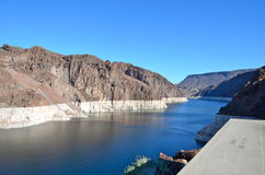 Lake Mead behind Hoover Dam Nevada. Sunny afternoon view of the water level reduction at Lake Mead behind Hoover Dam from the Arizona side Royalty Free Stock Photo