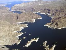 Lake Mead and mountains. Aerial view of Lake Mead which is located  in the states of Nevada and Arizona. Formed by water impounded by the Hoover Dam Stock Images