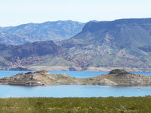 Lake Mead Recreational Area. Sunny day on Lake Mead with sailboat in bottom right corner Royalty Free Stock Photos