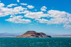 Lake Mead rock formation with clouds stock photo