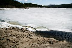 Lake with melting ice Stock Images
