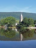 Lake Menteith, Scotland. A view across Lake Menteith in Scotland showing the church reflected in the lake Stock Photos