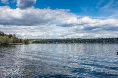 Lake And Mercer Island. A view of Mercer Island across Lake Washington . Shot taken from Seward Park in Seattle Royalty Free Stock Image