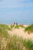 Lake Michigan Beach. A family walking to the beach to spend a day in the sunshine Royalty Free Stock Image