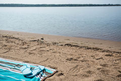 Lake Michigan Beach With Blue Flip Flops on Towel Corner Stock Photography