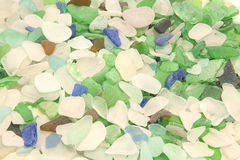 Lake Michigan Beach Glass in Shades of Whites, Green, Aqua, Royal Blue, and Brown. An array of hundreds of pieces of beach glass, or sea glass, in various colors Stock Image