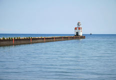 Lake Michigan lighthouse. Lighthouse at end of pier is one of Lake Michigan's oldest operating lighthouses Stock Photography