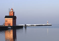 Lake Michigan Lighthouse in Morning Light. A Lake Michigan Lighthouse and the Holland Channel at Ottawa Beach in the early morning light of a late winter day Royalty Free Stock Images