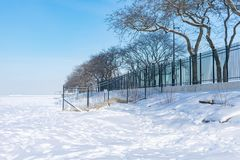 Lake Michigan at Ohio Street Beach in Chicago Frozen Over and Covered with Snow after a Polar Vortex royalty free stock images