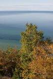 Lake Michigan scenic. Scenic view of Lake Michigan with autumn colored vegetation in foreground, Michigan, U.S.A royalty free stock photography