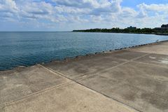 Lake Michigan Shoreline Along Racine Wisconsin. Waters looking southwest from south pier in Racine Wisconsin with clouded sky stock images