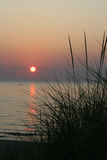 Lake Michigan Sunset. Summer sunset on great Lake michigan setting sun sawgrass beach water reflection watersport stock photography