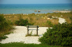 Lake Michigan USA. Empty bench in the sand on Lake Michigan USA stock photography