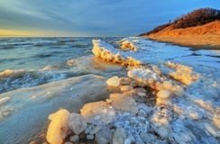 Lake Michigan Winter Shoreline. Iced shoreline of Lake Michigan near sunset, Saugatuck Dunes State Park, Michigan, USA Stock Photo