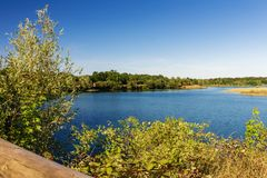 A lake in the middle of a beautiful nature reserve, peaceful and quiet.  Royalty Free Stock Photo