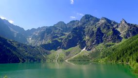 Lake in the middle of the Tatras mountains at sunrise, Poland stock video footage