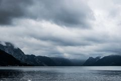 Lake in the midst of dark mountains Royalty Free Stock Photos