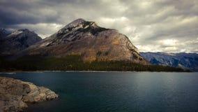 Lake minnewanka bannf mountains view storm Royalty Free Stock Photos
