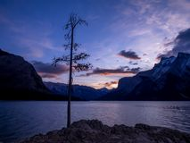 Lake Minnewanka at sunrise. Lake Minnewanka Water of the Spirits at sunrise in Banff National Park Alberta Canada Stock Photos