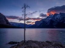 Lake Minnewanka at sunrise. Lake Minnewanka Water of the Spirits at sunrise in Banff National Park Alberta Canada Stock Photography