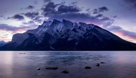 Lake Minnewanka at sunrise. Lake Minnewanka Water of the Spirits at sunrise in Banff National Park Alberta Canada Royalty Free Stock Photography