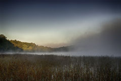 Lake in mist stock photography