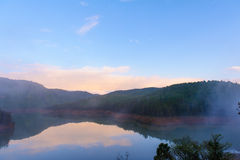 Lake with mist in morning Stock Photos