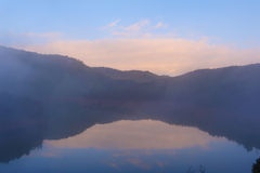 Lake with mist in morning Stock Images
