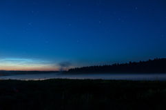 Lake mist night star sky Stock Image