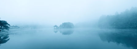Lake in the misty rain. The lake amidst misty rain Stock Photo