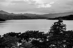 The lake in monochrome and mountains in the distance Royalty Free Stock Photo