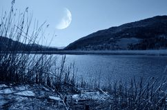 Lake with moon in the sky Royalty Free Stock Photography