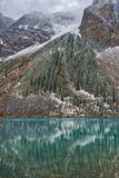 Lake Moraine, Alberta, framed by trees Royalty Free Stock Photography