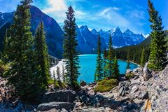 Lake Moraine in Canadian Rockies. Lake Moraine with icy water of emerald color in the Valley of the Ten Peaks. Park Banff, Canadian Rockies, Province of Alberta royalty free stock images