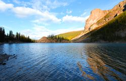 Lake Moraine under evening sun Royalty Free Stock Images