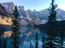 Lake Moraine View in Banff. Fantastic Mountain peak Reflection in Blue lake water royalty free stock photography