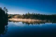 Lake in the morning at sunrise stock photography