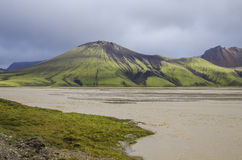 Lake and moss-covered volcanic mountains. Landmannalaugar. Icela. Nd Stock Photography