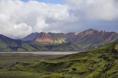 Lake and moss-covered volcanic mountains. Landmannalaugar. Icela. Nd Royalty Free Stock Photo