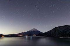 Lake Motosu and mt.Fuji at night time. In winter season. Lake Motosu is the westernmost of the Fuji Five Lakes and located in southern Yamanashi Prefecture near stock photos