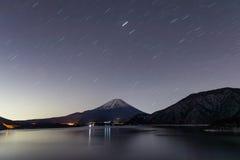 Lake Motosu and mt.Fuji at night time stock photos