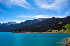 Lake and mountain. Green mountain with blue lake and sky Stock Photography